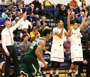The Canisius bench cheers on a three-pointer.