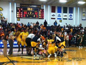 The team piled on Mills after the shot went in.