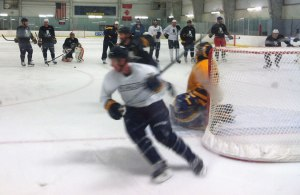 Jordan Leopold skates by the net in a small-sided drill.