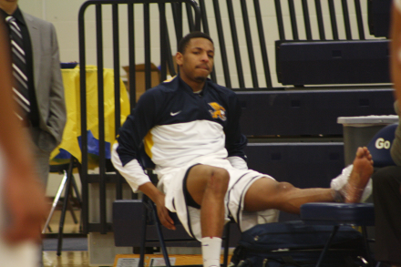 Zach Lewis ices his ankle on the end of the bench. Photo by Jourdon LaBarber.
