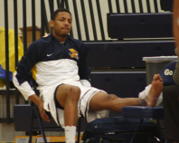 Zach Lewis ices his ankle on the end of the bench. (Photo by Jourdon LaBarber)