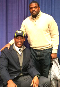 TJ Wheatley poses with his father, Michigan running backs coach Tyrone Wheatley.